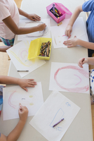 Students drawing in classroom