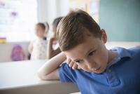 Sad student leaning on desk