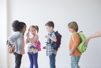 Students wearing backpacks in classroom