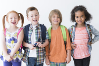 Smiling children wearing backpacks