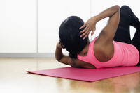 Mixed race woman doing sit-ups