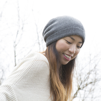 Japanese woman wearing beanie outdoors