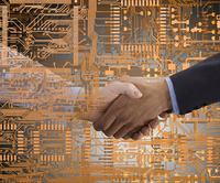 Business people shaking hands in microchip