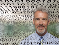 Caucasian businessman in streams of binary code