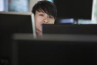 Vietnamese businessman sitting at computer