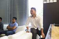 Businessmen sitting in office meeting