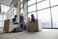 Business people talking in office lounge