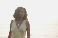 Hispanic woman standing outdoors