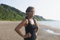 Hispanic woman standing on beach