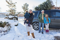 Caucasian family smiling in snow