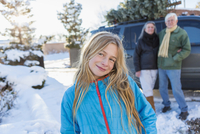 Caucasian girl smiling in snow