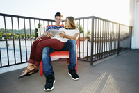 Couple using digital tablet on patio