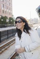 Hispanic woman waiting for train