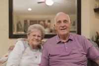 Older Caucasian couple smiling indoors