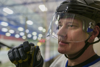 Caucasian hockey player wearing helmet