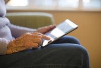 Older Caucasian woman using digital tablet