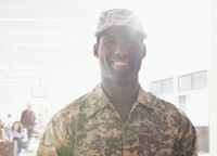 African American soldier smiling in fatigues