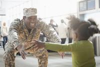 Returning soldier greeting daughter