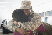 Returning soldier hugging wife