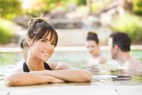 Woman smiling in swimming pool