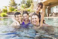 Couples smiling in swimming pool