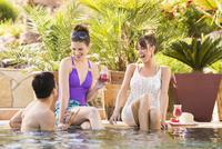 Friends talking in swimming pool