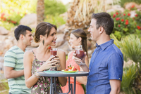 Couple having cocktail at outdoor patio