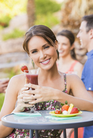 Woman drinking cocktail outdoors