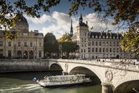 Buildings and bridge over river in Paris, Ile-de-France, France
