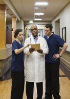 Doctor and nurses using digital tablet in hospital