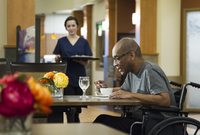 Patient eating in hospital cafeteria