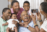 Black family taking cell phone photograph