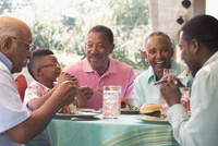 Black family eating at barbecue