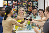 Friends toasting with wine at dinner party