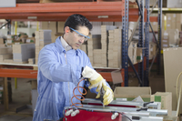 Hispanic technician working in factory