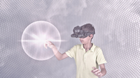 Mixed race boy wearing virtual reality goggles