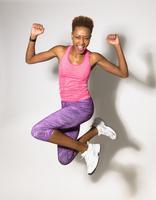 Mixed race athlete jumping for joy 11018069190| 写真素材・ストックフォト・画像・イラスト素材|アマナイメージズ