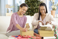 Mother and daughter wrapping Christmas gifts