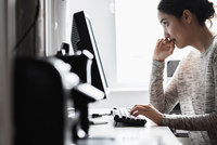 Hispanic woman using computer