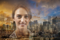 Double exposure of Caucasian businesswoman and cityscape