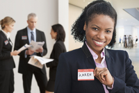 Businesswoman wearing name tag in office