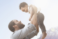 Smiling father holding baby daughter