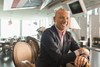 Caucasian businessman smiling in bar