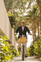 Caucasian businessman riding bicycle
