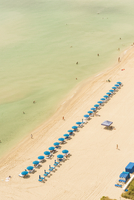 Aerial view of lawn chairs on beach