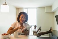 African American woman using digital tablet