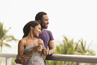 Couple admiring scenic view from balcony