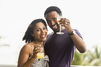Couple drinking cocktails outdoors