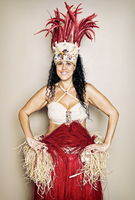 Mixed race hula dancer wearing traditional costume