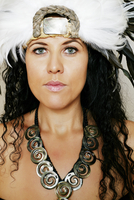 Mixed race hula dancer wearing traditional costume